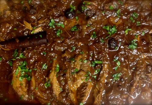 Brisket sliced and coated with sauce