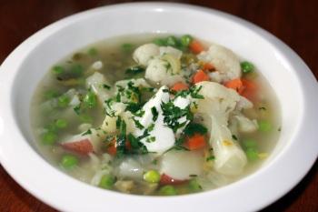 Beautiful soup, with cauliflower and fresh sugar snap peas