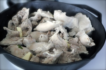Chicken pieces, cooked, going into the oven