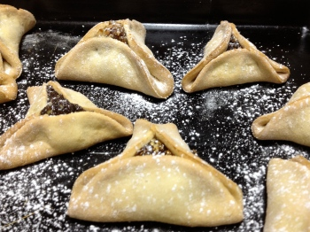 Hamantashen, lightly dusted with powdered sugar