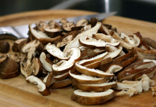 Sliced shiitake and portobello mushrooms