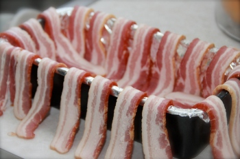 Meatloaf mold lined with bacon slices