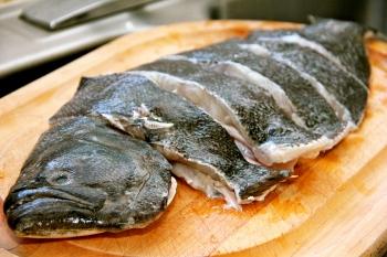 Medium large flounder, cleaned, fins removed, and sliced