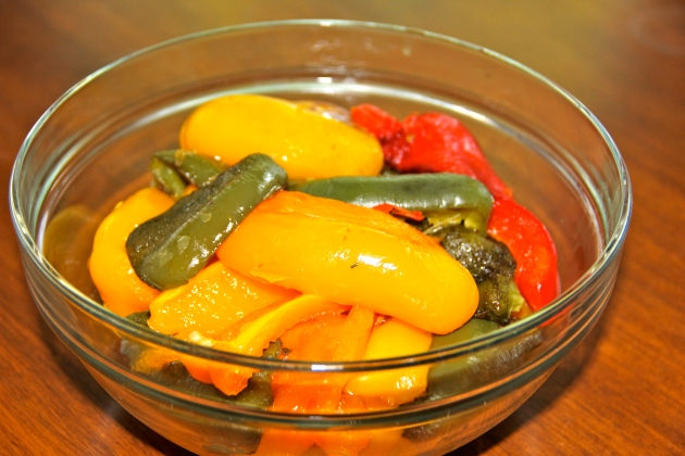 Peeled peppers are resting in a bowl