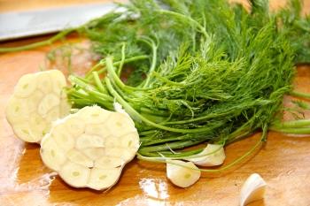 Basic pickling kit -- sliced garlic head and dill weed