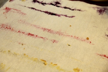Fruit juice streaks on the parchment.