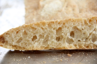 A slice of freshly baked ciabatta