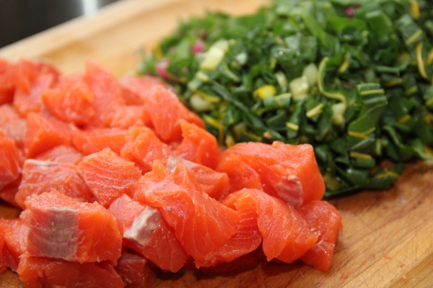 Beautiful cubed Coho salmon and shredded chard leaves