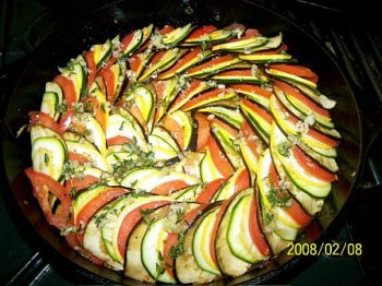 Raw vegetables layered over piperade for Confit Byaldi