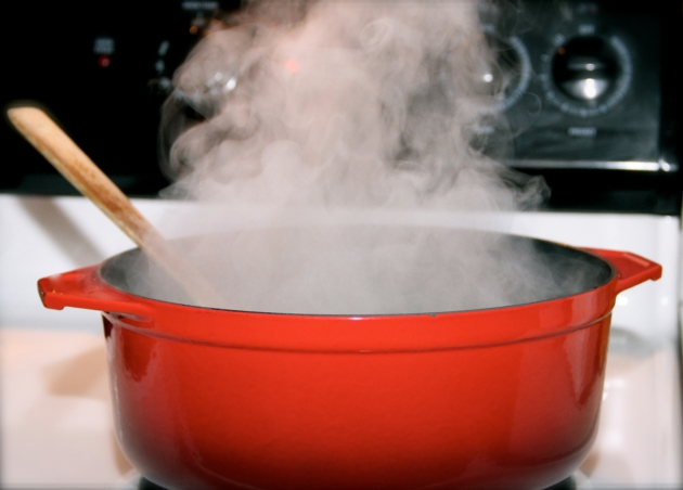 Steam rising over the Dutch oven