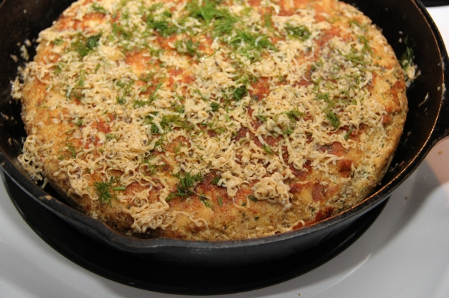 Making Fish Roe Skillet Pie -- melting the cheese