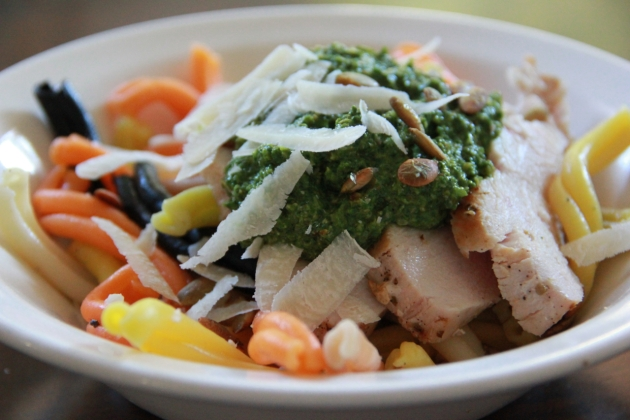 Putting together Spinach & Pumpkin Seed Pesto Pasta Bowl