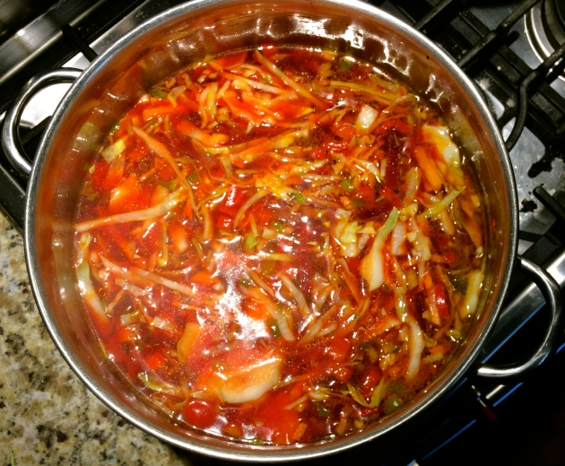 Making Borscht: adding shredded cabbage